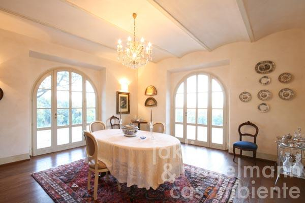 The dining room with large French doors, which lead onto the surrounding terraces