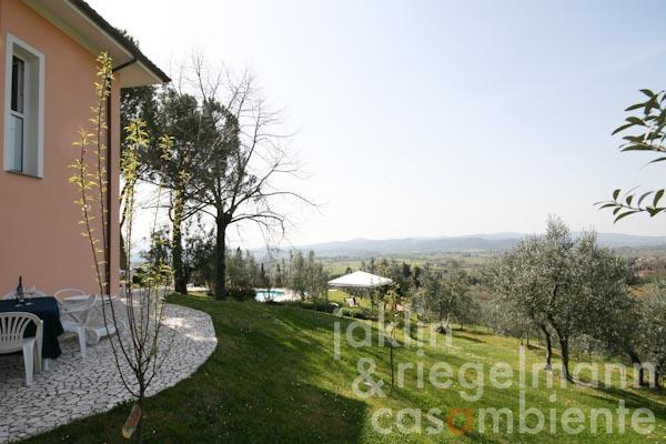 The view across the garden and the dreamlike panoramic view from the property