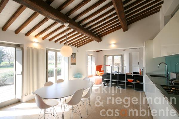 The spacious eat-in kitchen with four French doors, which lead onto the terraces and into the garden