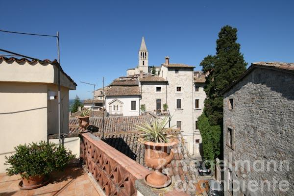 The view from the private roof-terrace onto the church of San Fortunato in Todi