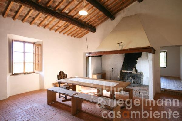 The eat-in kitchen with open fireplace on the first floor