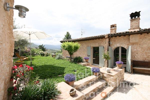 The tastefully restored village house for sale with garden and terraces close to Trevi in Umbria