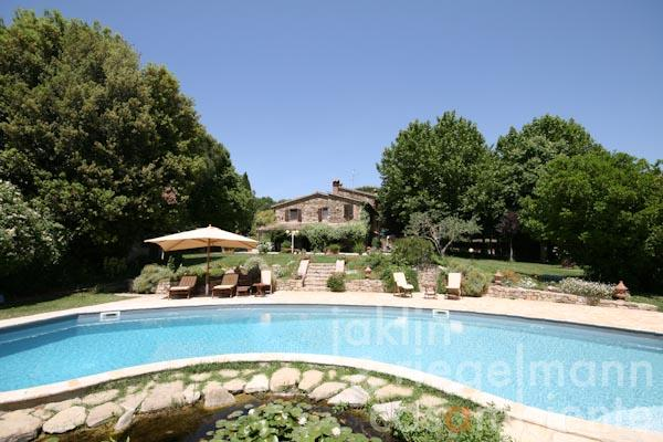 The view from the swimming pool towards the farmhouse
