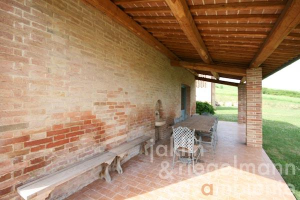 The loggia in front of the farmhouse