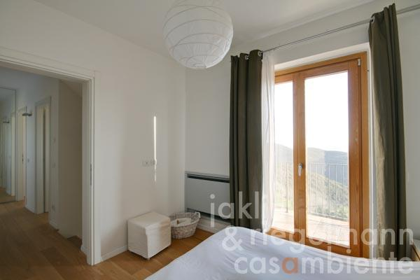 The bedroom with balcony and en-suite bathroom on the first floor