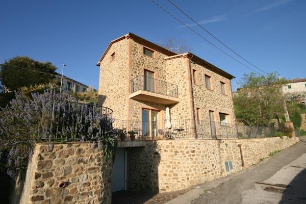 The restored town house for sale with views onto Castiglione della Pescaia and the sea
