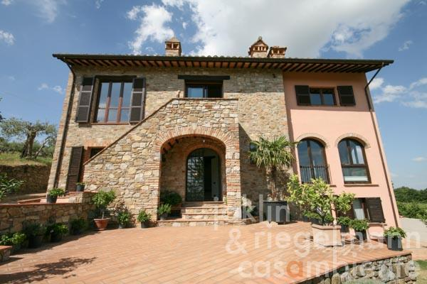The restored country house for sale in Umbria with large windows and olive grove in panoramic setting