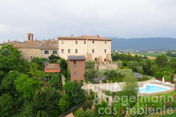 The exclusively restored historic castle for sale with plot of land and pool in panoramic setting close to Todi in Umbria