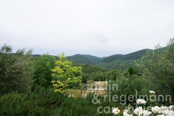 The private garden in front of the apartment with wide panoramic views across the green hills