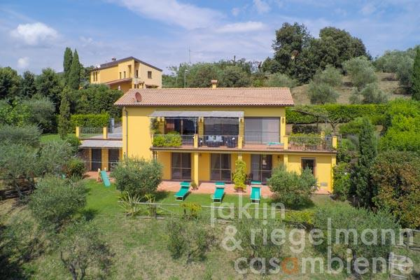 The modern villa for sale with sea view in the hills above the seaside town Viareggio in Tuscany