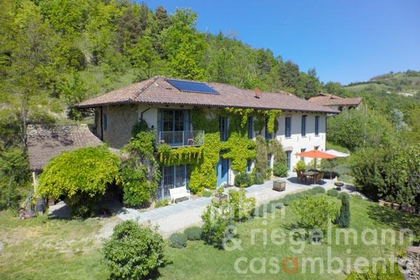 The tastefully restored country house for sale close to Alba in the Langhe region in Piedmont with beautiful garden and pool