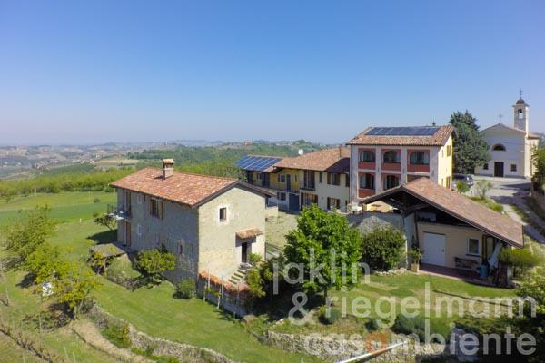 The restored farmhouses for sale in the Langhe area in Piedmont with vineyard and 180° views onto the Alps