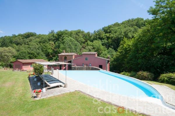 The elaborately restored former water mill for sale with four apartments in the Chianti foothills close to Florence