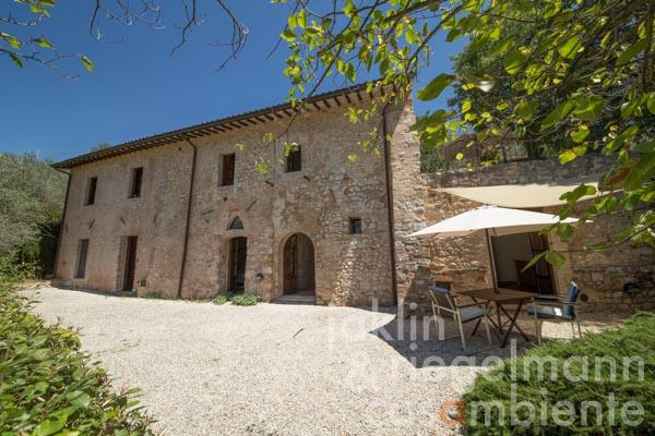 The beautifully restored stone country house for sale with olive grove and pool close to Trevi in Umbria