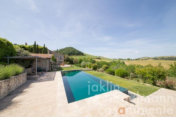 The tastefully restored Italian stone house for sale at the edge of a tiny village with spectacular views onto Todi