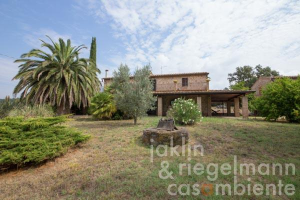 Characteristic country house in the Maremma near the sea with olive grove and cork oaks