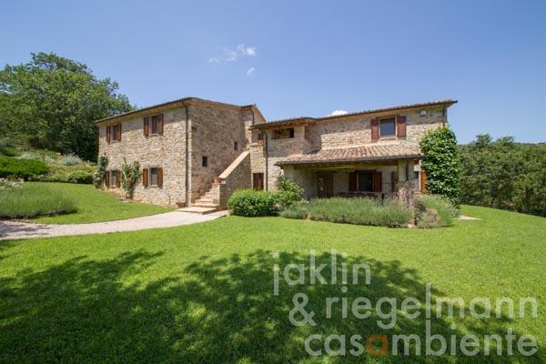 The beautifully restored Italian country house for sale with pool, located in a private gated estate in Umbria
