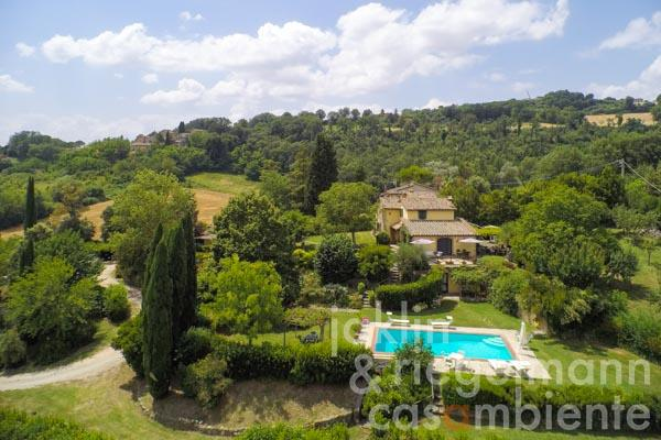 Beautiful Italian stone and plaster farmhouse for sale with pool and fenced garden near Todi in Umbria