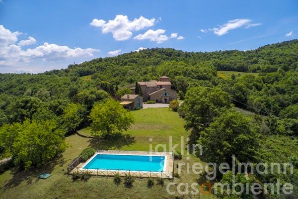 Restored natural stone property in a medieval village with views, garden and pool