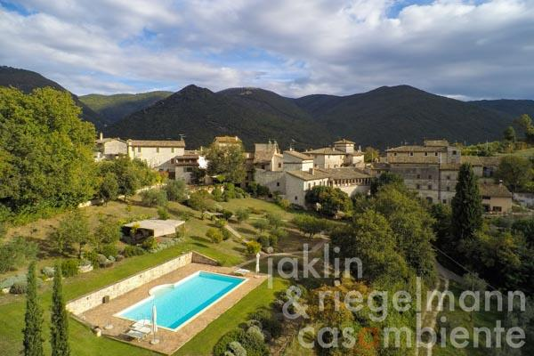 The unique historic Italian property for sale with medieval buildings, garden and pool close to Spoleto in Umbria