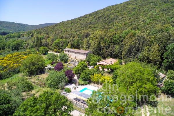 18th century restored farmhouse flanked by a separate guesthouse, studio and pool near Amelia